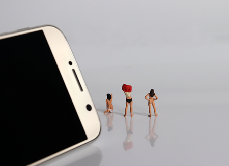Miniature women changing clothes. The concept of illegal video shooting.