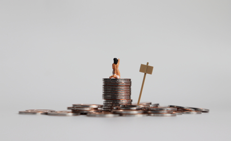 Stop selling people. Miniature woman and the pile of coins. Stock Photo