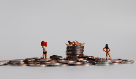 Coins and miniature women. Human trafficking concept. Not for sale campaign. Stock Photo