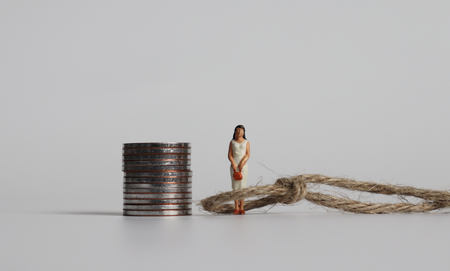 Miniature woman. The concept of discrimination in promotion of women.