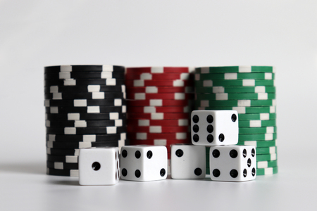 Casino chips and dice on a white background.