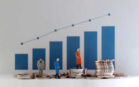 The concept of an increase in the population of the elderly and a poor old age. Blue bar graph with the stack of coins and miniature older people.