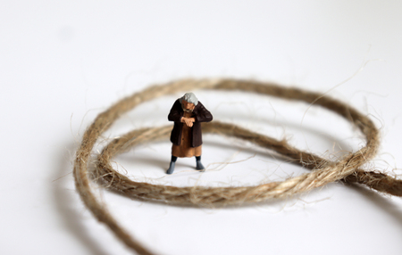 A miniature woman with a rope.