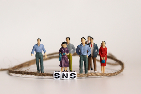 A SNS is an alphabetical cube that is connected by a string. Standing miniature people.