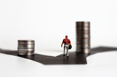 The back of a miniature people. The pile of coins on the two fork road.