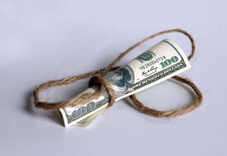 A hundred-dollar bill tied to a rope.