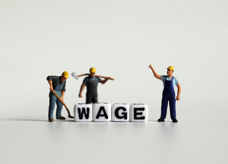 WAGE word in white cube. Miniature people. Imagens