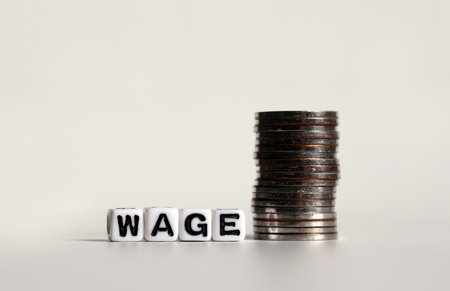 WAGE text in white cube and a pile of coins.