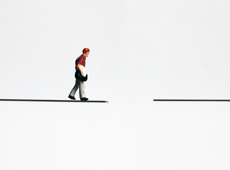 A miniature man walking with a bag. Stock Photo