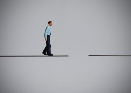 A miniature business man walking on a broken path.