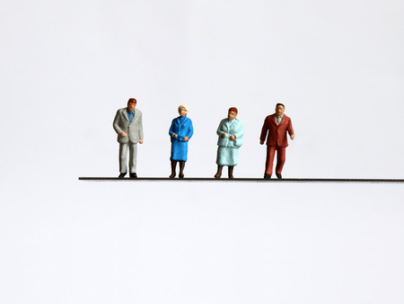 The concept of rapidly becoming an aging society. Miniature people.