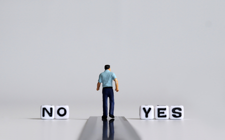 YES and NO text alphabet white cube. Miniature people.