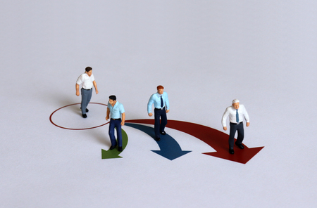 Miniature people located in different directions.