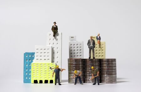 Miniature houses and miniature people. The concept of social and position inequality. Zdjęcie Seryjne