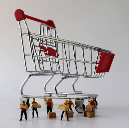 A shopping cart and miniature couriers.