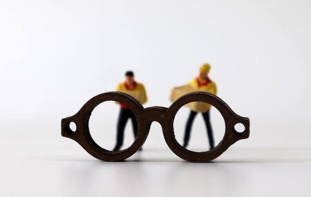 Miniature glasses and miniature couriers.