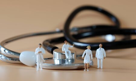 Stethoscope and Miniature medical staff. 免版税图像 - 145756328