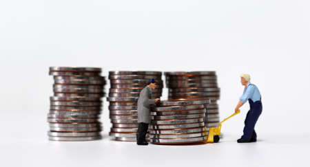 Miniature people carrying a pile of coins.