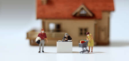Miniature people wearing masks. A concept about the importance of wearing a mask in everyday life.