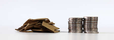 Piles of paper and coins. Miniature and business concept.