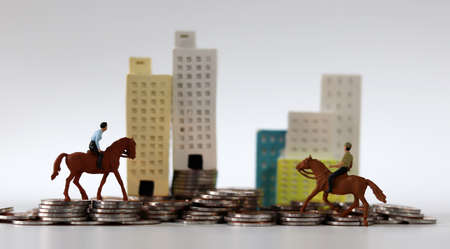 coins, miniature horses and miniature people.