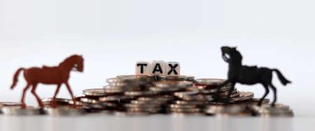 coins, miniature horses and tax 版權商用圖片