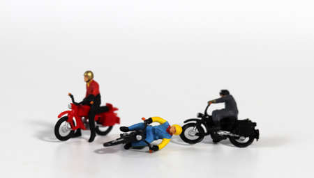 Miniature motorcycle rider. Miniature motorcycle driver who crashed. Concept about the risk of motorcycle accidents.