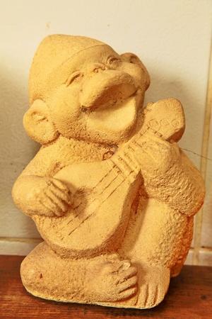 Statue of a monkey playing music Stock Photo - 11091782