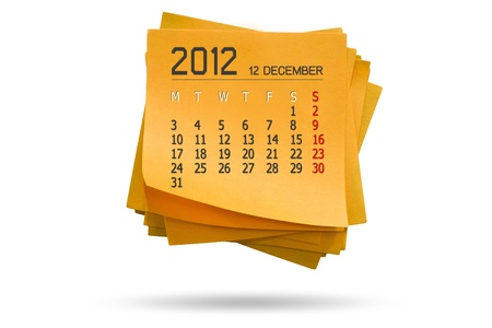 new year calendar 2012 on note paper Isolated orange background white  photo