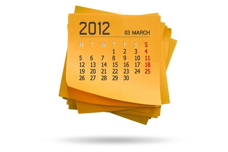 new year calendar 2012 on note paper Isolated orange background white  photo