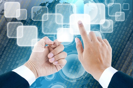 hand of business man pushing a button on a touch screen interface Stock Photo - 12932264
