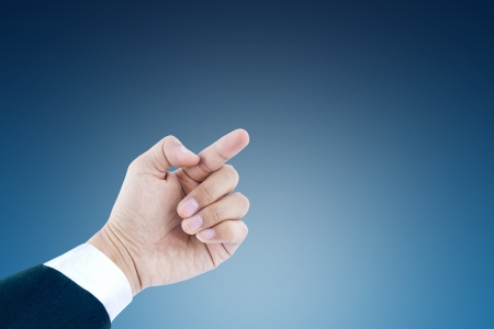 businessmen hand isolated on blue background  photo