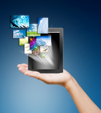 touch pad PC and streaming images buttons on women hand on background blue