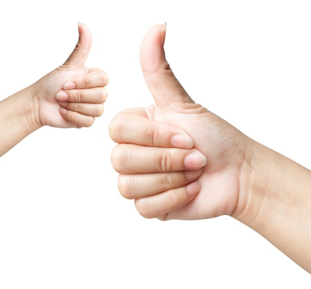 two thumbs up: Hand of women giving like on background white  Stock Photo
