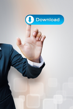 hand of business women pushing a download button a touch screen interface Stock Photo