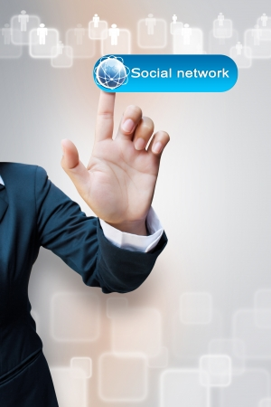 hand of business women pushing a Social network button a touch screen interface Stock Photo