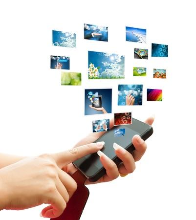 hand women touch smart phone in hand on white background  Standard-Bild