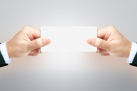 Hand of women holding blank paper label or tag on white background