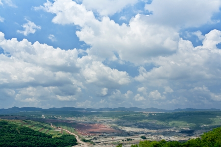 Landscape of coalmine with cloudy, mountain on asia Moh lampang thailand photo