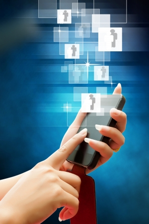 hand of business women pushing a button on a interface touch smart phone on background blue Stock Photo - 16218165