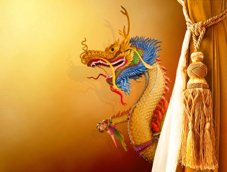 Dragon statue on brown background curtain photo
