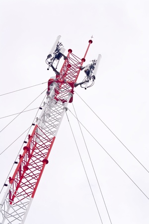 transmit: Telecommunication tower used to transmit television and 3g signals isolated on white