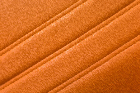 Orange leather for texture background from Office Chair Фото со стока