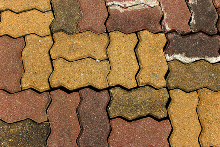 Red paving stones Brick worm on the walkway as background photo