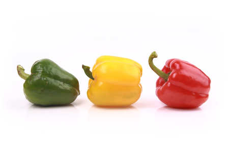 Colorful sweet peppers isolated on white background. Standard-Bild