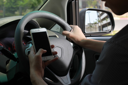 danger: phone while driving danger Stock Photo