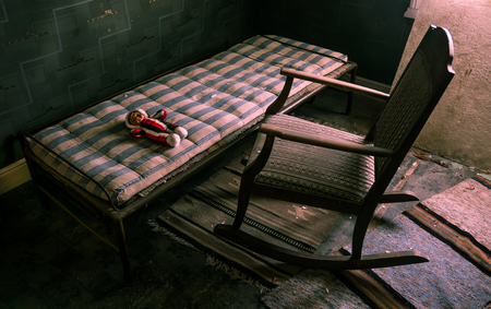 A doll laying on the bed in front of an empty old wooden rocking chair. As if someone was watching over it.