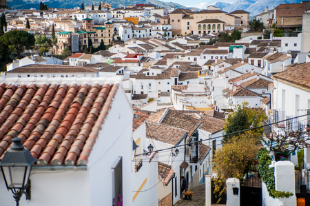 Lots of small white houses in the mountain town of Ronda in Spain. Stock Photo