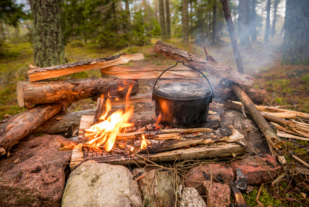 Pot kettle on a campfire in the forest