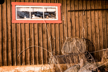 Fishing and hunting gear on a house wall. Some copy space for text as well. Stock Photo